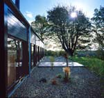 A slate and gravel patio extends the Cedar House living space into the garden.