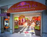 Pawsenclaws & Co. is a colorful department store fantasy that stands out in its mall surroundings.